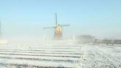Windmill of square wrapped in snow, morning sun and morning mist-2